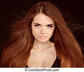 Beautiful girl with flying blond hair. Brown Long Hair.