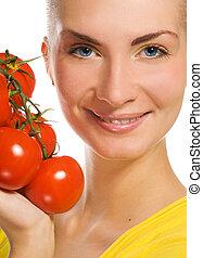 Beautiful girl with fresh tomatoes