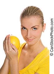 Beautiful girl with grapefruit