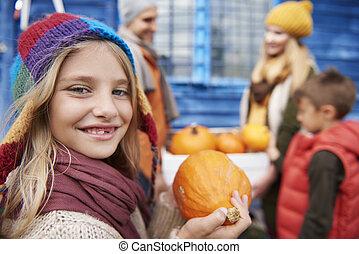 Beautiful girl with Halloween pumpkin