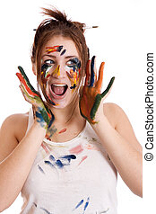 beautiful girl with hands in the paint