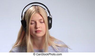 Beautiful girl with headphones enjoying music - Beautiful...