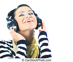 Beautiful girl with headphones. Isolated on a white