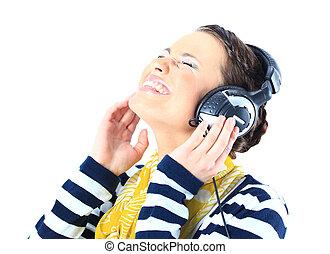 Beautiful girl with headphones. Is