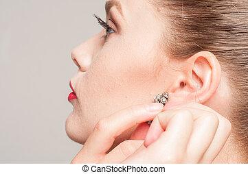 beautiful girl with his earring