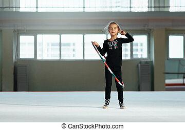 beautiful girl with  hoop of rhythmic gymnastics.