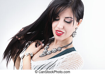 Beautiful girl with jewelry. beauty young woman make-up