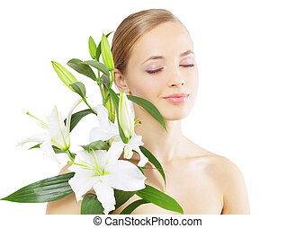 Beautiful girl with lily flower Isolated on white