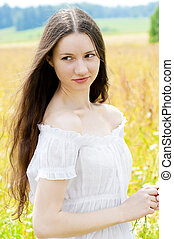 beautiful girl with long hair in field