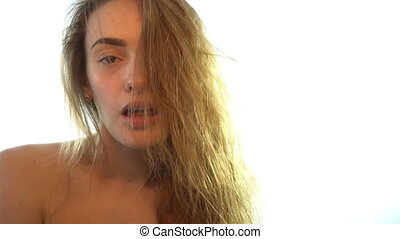 beautiful girl with long hair looks with sexual gaze -...