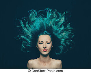 Portrait of smiling beautiful girl with closed eyes and long hair of turquoise color, top view. Image of mermaid