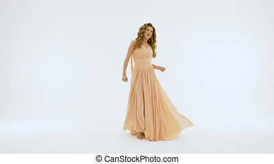 Beautiful girl with long hair, she sings on a white background.