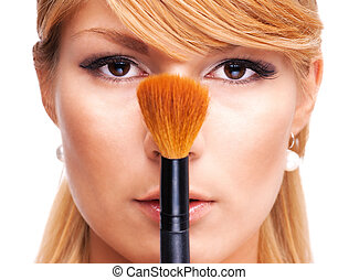 Beautiful girl with make-up brush