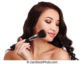 Beautiful girl with make-up brush.