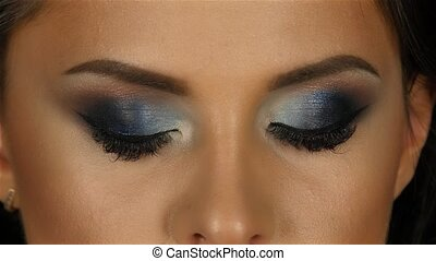 Beautiful girl with makeup breath taking looks straight and...