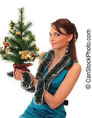 Beautiful girl with new-year tree.
