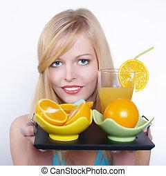 Beautiful girl with orange and juice