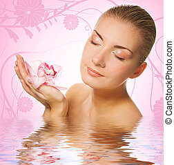Beautiful girl with orchid flowers in rendered water