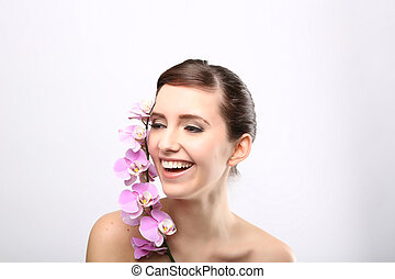 Beautiful Girl With Orchid Flowers.