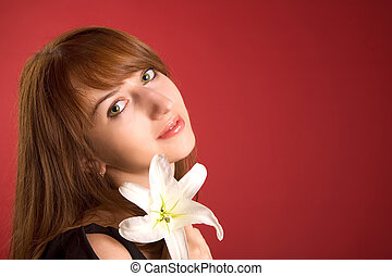 Beautiful girl with orchid, lot of copy-space