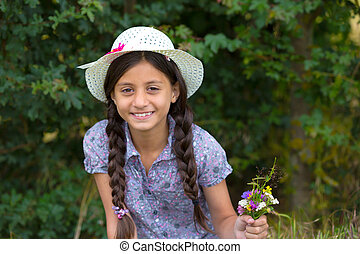Beautiful girl with picked flowers