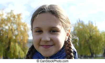 Beautiful girl with pigtails.