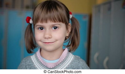 Beautiful girl with pigtails look at the camera