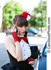 beautiful girl with red bow-tie, cap and gloves