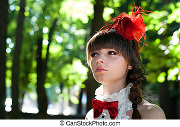 beautiful girl with red bow-tie cravat