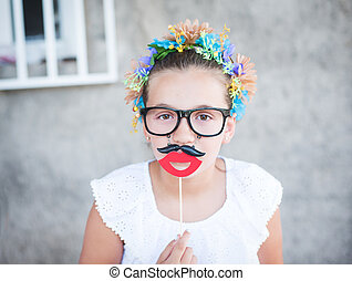 Beautiful girl with Santa beard and mustache prop or mask.