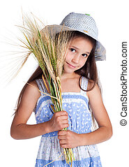Beautiful girl with sheaf of wheat