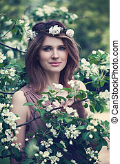 Beautiful Girl with Spring Flowers