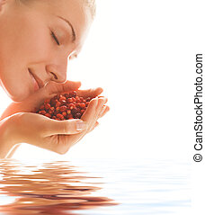 Beautiful girl with strawberries in rendered water