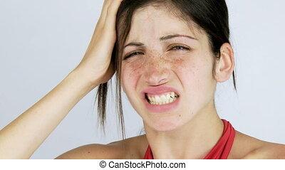 Beautiful girl with strong headache