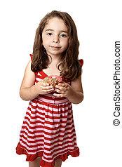 Beautiful girl with sweet doughnut