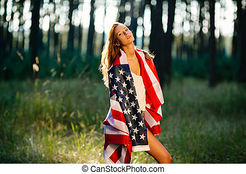 Beautiful girl with the American flag.