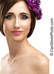 Beautiful girl with violet flowers in her hair beauty shot