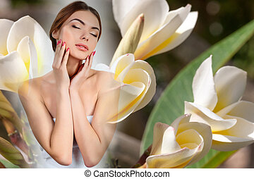 Beautiful girl with white frangipani flowers