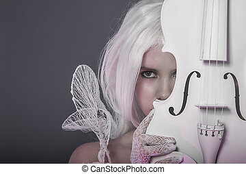 Beautiful girl with white violin