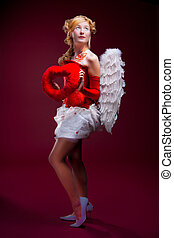 Beautiful girl with white wings