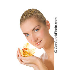 Beautiful girl with yellow orchid isolated on white