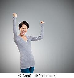 Beautiful girl yes gesturing is happy