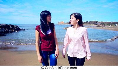 Beautiful girls chatting walking