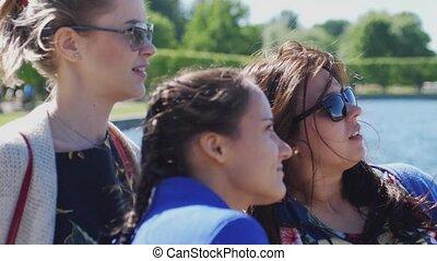 Beautiful girls in sunglasses enjoying the sunlight smiles...
