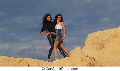 Beautiful girls on the skyline