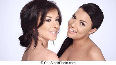 Beautiful Girls Posing In Studio on White