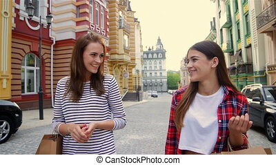 Beautiful girls with shopping bags in city