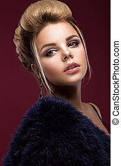 Beautiful glamor blondie woman in fur coat , evening makeup and hairstyle. The beauty of the face.