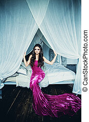 Beautiful glamorous brunette in gorgeous dress