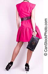 Beautiful glamorous woman in dress